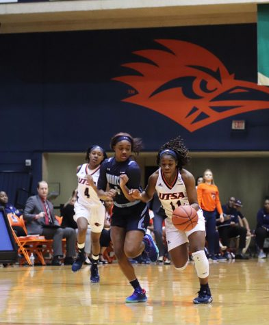 Charlene Mass dribbles around the Old Dominion defense. The Roadrunners lost both games of the weekend.