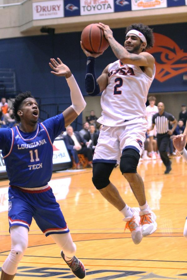Jhivvan Jackson shoots the ball over a Louisiana Tech defenders. Jackson has moved into the all-time leading scorer position.