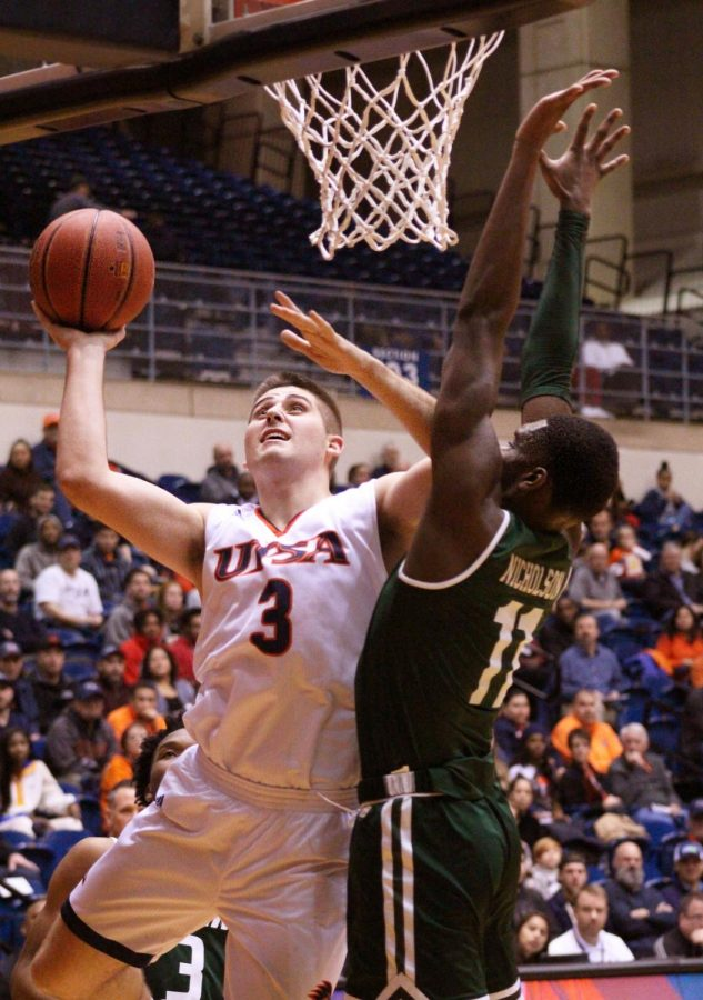 Byron Frohnen shot a layup in a game against the University of Alabama at Birmingham Blazers. Frohnen plays power forward for the UTSA men's basketball team.