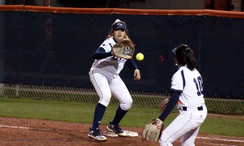 Victoria Villarreal catches a throw from Clarissa Hernandez. The 'Runners went 3-2 in the Bobcat Classic.