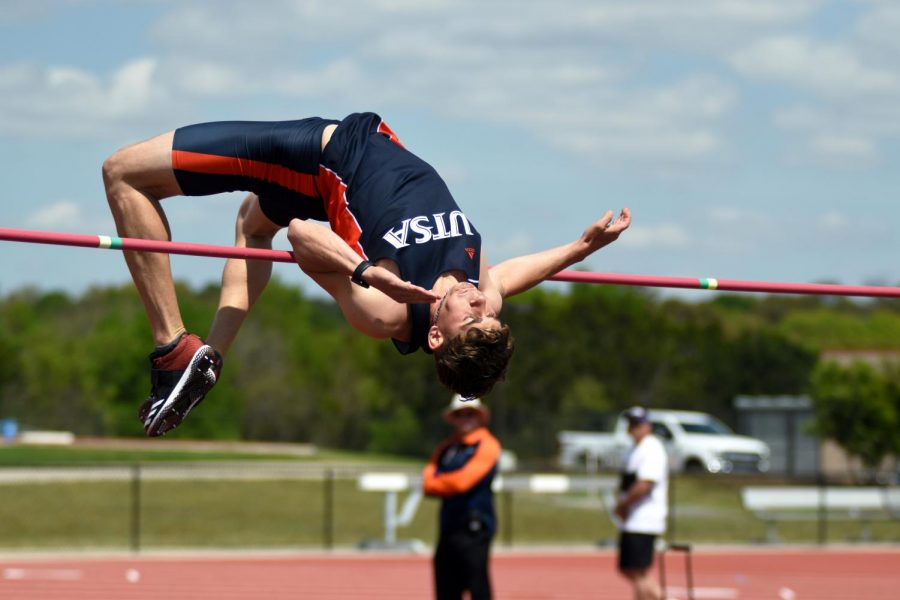 Jake+McDaniel+glides+over+the+bar+during+high+jump.+Both+track+teams+competed+in+the+Houston+G-5+and+Mid-Major+Invitational+over+the+Jan.+31+weekend.