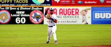 Joshua Lamb throws an infielded ball to the first second baseman. Lamb is a shortstop for the baseball team.