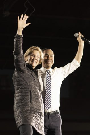 Elizabeth Warren and Julián Castro embrace at Warren's San Antonio rally. Castro has endorsed Warren for president since he dropped out of the presidential race several month ago.