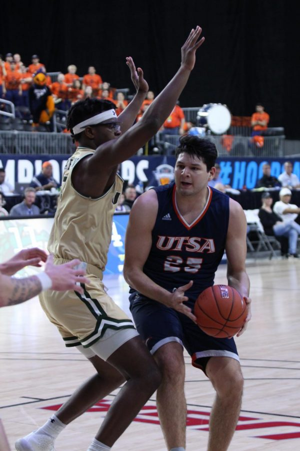 Adrian Rodriguez finds himself under the rim looking to score a basket at the C-USA Basketball Championships.