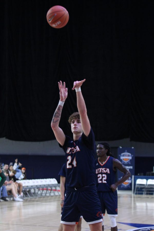 Jacob Germany shoots a free throw during a first round matchup against the UAB Blazers at the C-USA Basketball Championships.