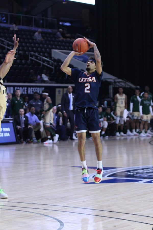 Jhivvan Jackson takes a jump shot during the first round matchup against the UAB Blazers at the Conference USA Championships.