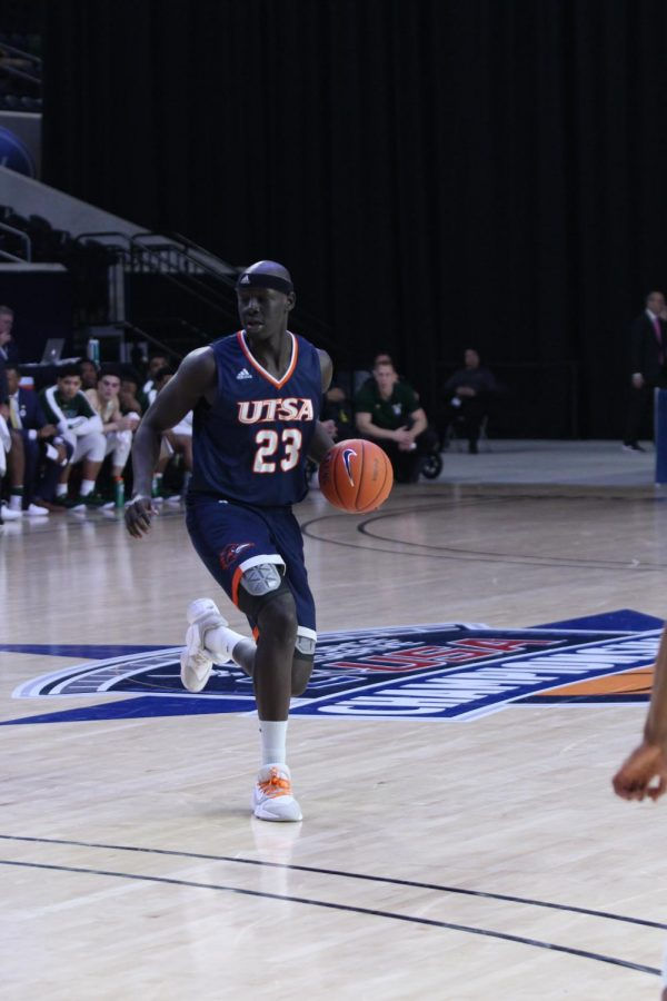 Atem Bior brings the ball up the court. Bior played his final game as a Roadrunner in a loss to the UAB Blazers at the C-USA Championships in Frisco, Texas.