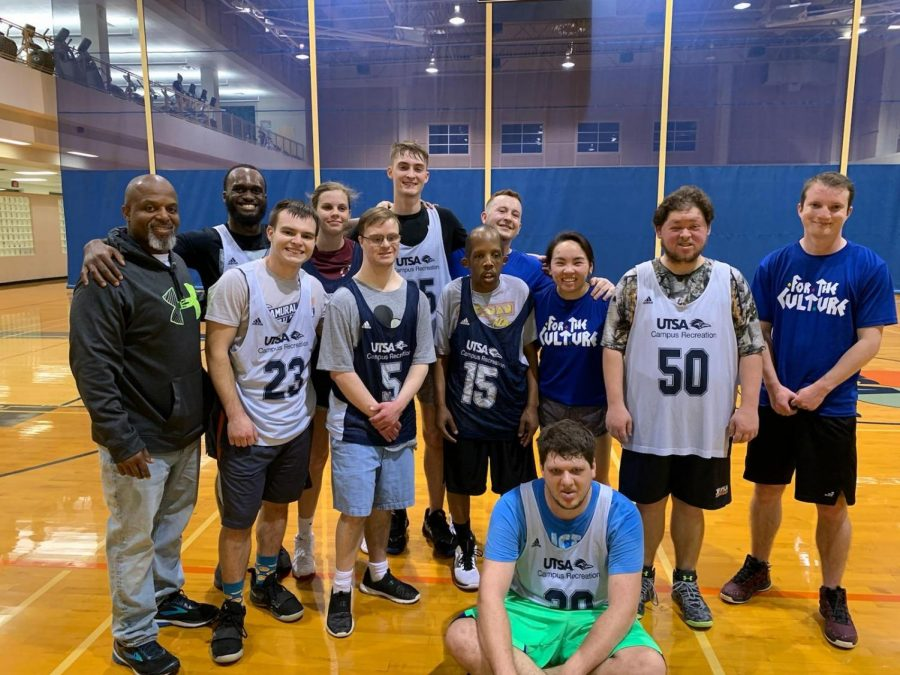 The UTSA rec and Special Olympics partnership will continue during the COVID-19 pandemic. Perry (15) and Kyle (50) are pictured with their team.