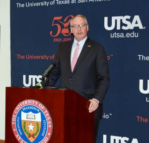 President Eighmy speaks at a podium. Eighmy announced on May 11 that UTSA campuses will reopen in the coming fall.