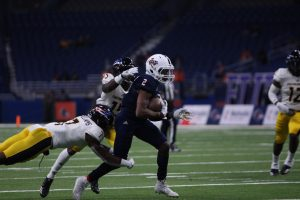 Sheldon Jones breaking a tackle during a home game against the University of Southern Miss. The Roadrunners have played every home game in the Alamodome since they began play in 2011.