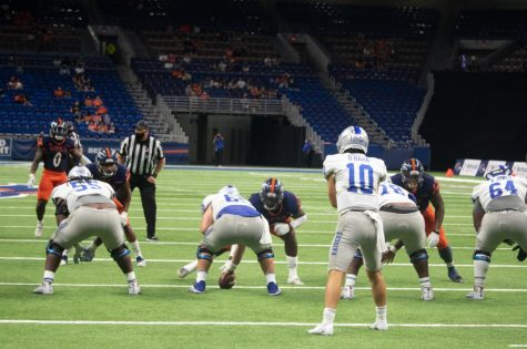 Middle Tennessee quarterback Asher O'Hara stares down UTSA safety Rashad Wisdom before the snap. The 'Runners intercepted O'Hara twice on Friday.