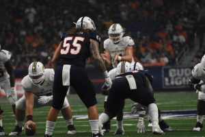 Former UTSA linebacker Josiah Tauaefa stares down Texas State's quarterback before the snap in a 2018 game. The 'Runners won 21-25.