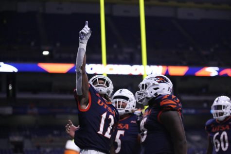 wide receiver joshua cephus points to the sky after scoring a touchdown. Cephus has been a key part of a substantially improved Roadrunner offense this season.