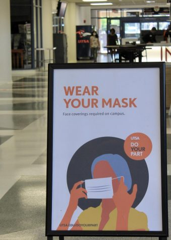 A sign in the Student Union tells university community members to wear face coverings. The signage is part of UTSA