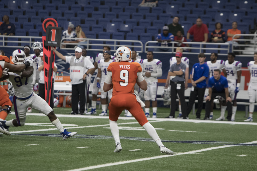 Quarterback Jordan Weeks looks to pass in a game against LA Tech during the 2018 season.