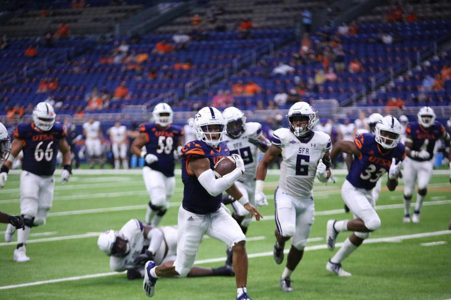 Quarterback Frank Harris runs past Stephen F. Austin's defense during the second game of the season. Harris' scrambling ability contributes greatly to UTSA's efficient rushing attack.