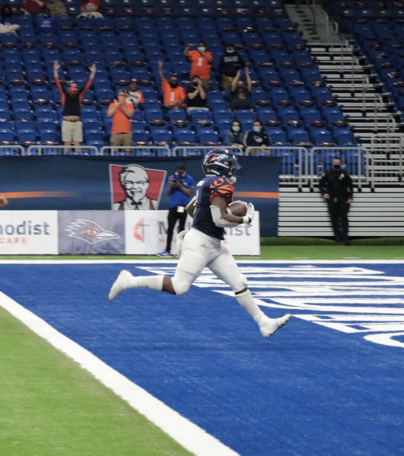 Sincere McCormick rushes past every defender on the field and into the end zone in a game against LA Tech earlier this year. McCormick did much of the same after missing last weeks game, and is now UTSA's single season rushing record holder.