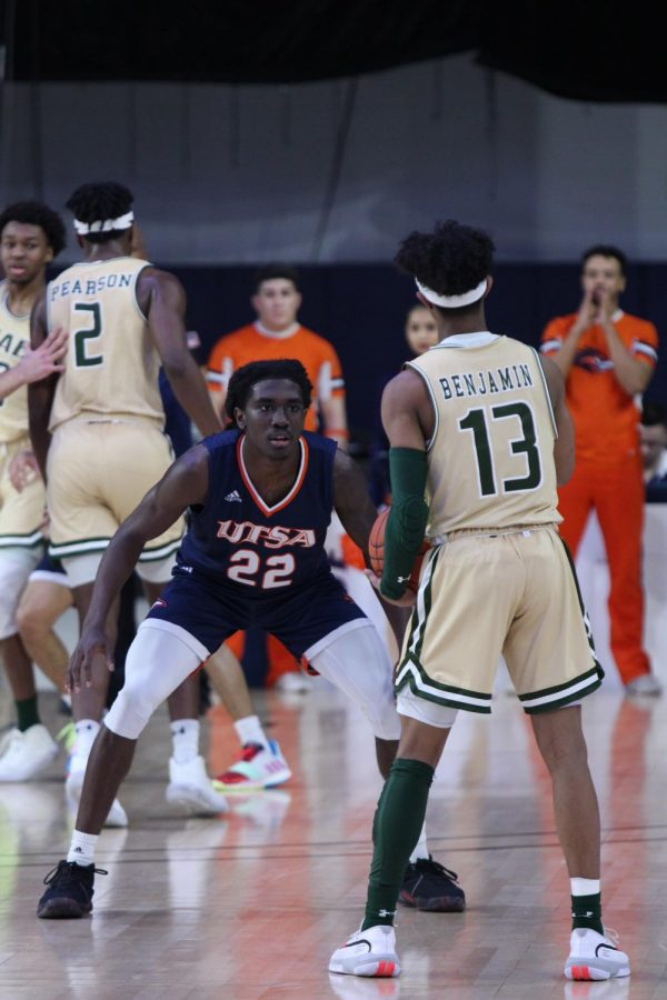 Keaton Wallace gets into his defensive stance as UABs Jalen Benjamin brings the ball up the court in last years Conference USA tournament.