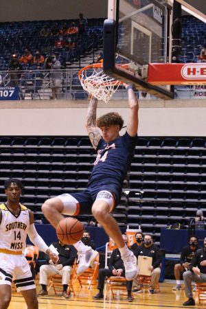 Jacob Germany throws down a thunderous dunk during Saturday's game against the Golden Eagles. Germany averaged 12 points and 9.5 rebounds over the weekend.
