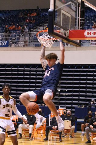 Jacob Germany throws down a thunderous dunk during Saturdays game against the Golden Eagles. Germany averaged 12 points and 9.5 rebounds over the weekend.
