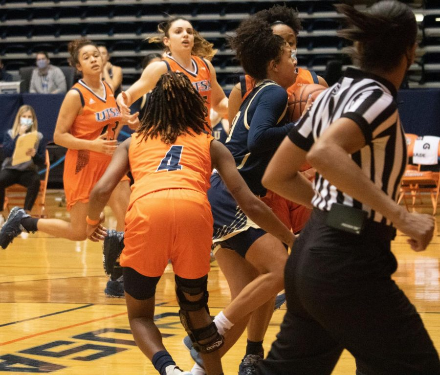 UTSA defenders Mikayla Woods, Yuliyana Valcheva, Karrington Donald, and Kyleigh McGuire swarm an FIU player during a game earlier this season.