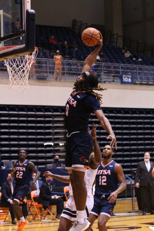 Cedric Alley Jr. soars through the air for a dunk during a game earlier this season. The redshirt junior transfer from Houston is currently averaging 5.9 points and 4.1 rebounds per game.