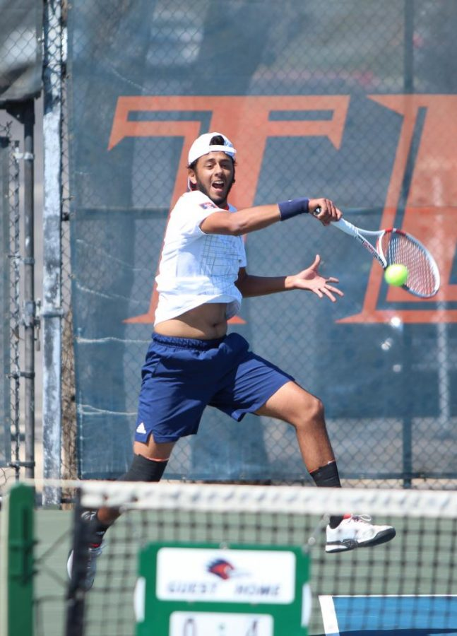 Sebastian Rodriguez returns the ball during a match earlier this season.  Rodriguez holds a 6-6 record in singles play this year. In doubles play when partnered Joao Ceolin, the duo is 7-1.