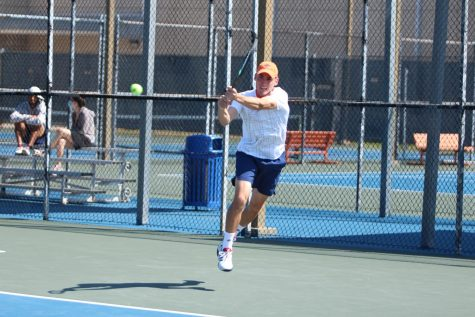 Joao Ceolin returns a ball during a match earlier this season. Ceolin has compiled a 10-3 overall record in singles play and  an overall mark of 9-4 in doubles.