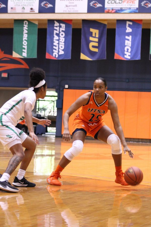 Shannan Mitchell surveys the court during a game against North Texas. Mitchell appeared in 15 games for the Runners this year, starting six of them.