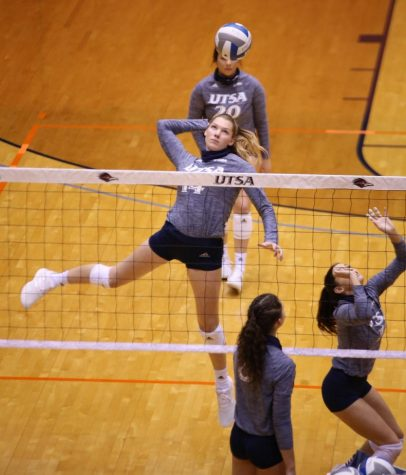 Allison Jennings warms up before a game earlier this season. The junior has appeared in nine games for the Runners this year, contributing 29 kills.