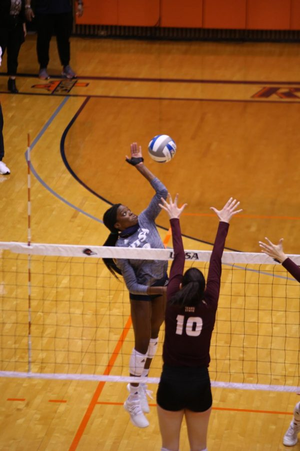 Bianca Ejesieme readies to hit a cross court shot during a game earlier this season. Ejesieme finished third on the team this season with 160 kills.