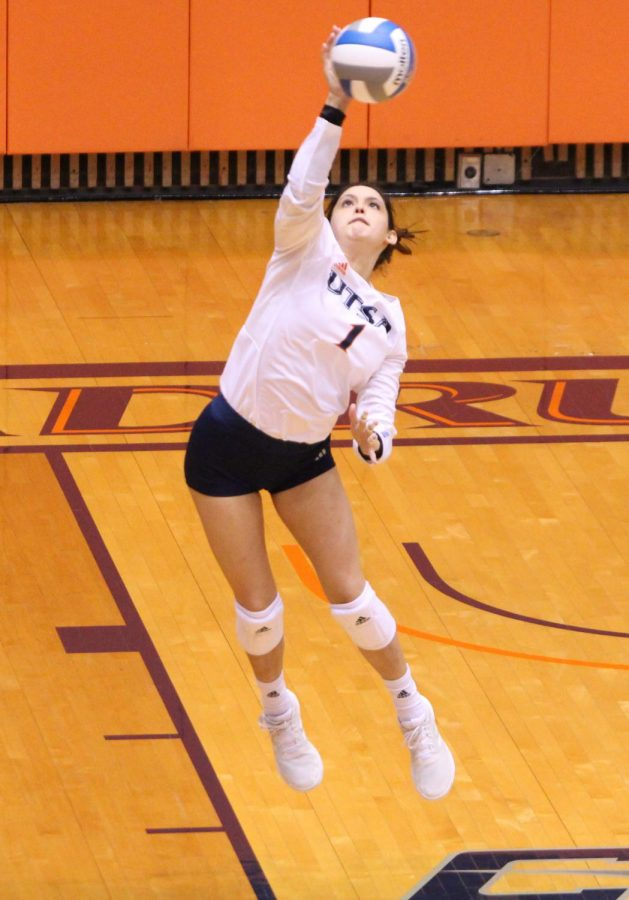 Mia Perales serves up a ball during a game earlier this season. The junior setter and San Antonio native has appeared in eight of UTSA's 11 matches so far this season.