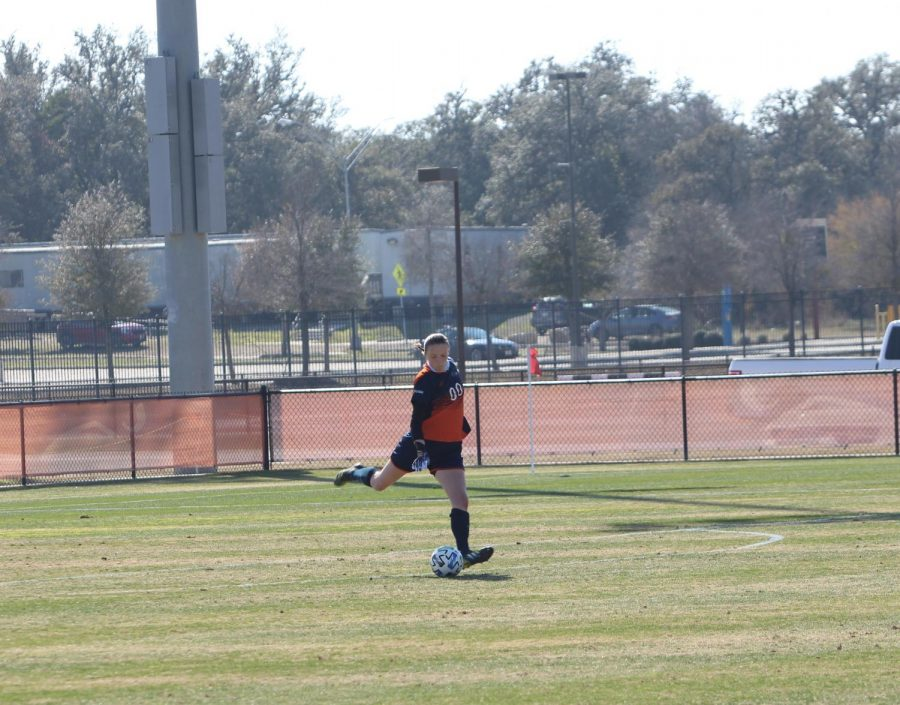 Jil Schneider clears the ball away during a game earlier this season. The sophomore keeper has appeared in all eight games for the 'Runners this season, starting in seven of them.