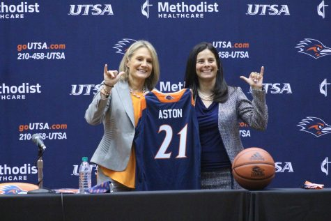 Karen Aston and Dr. Lisa Campos pose for a photo during Aston's introductory press conference on Friday, April 2. Aston takes over as the 10th head coach in the 'Runners' history.