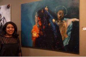 """Elexis Hernandez posing beside her painting """"Insomnia."""""""