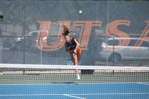 Alexsandra Zlatarova fires a serve over the net during her singles match against Texas-Arlington. Zlatarova has compiled an 11-5 record in singles play and a combined record of 10-5 in doubles.