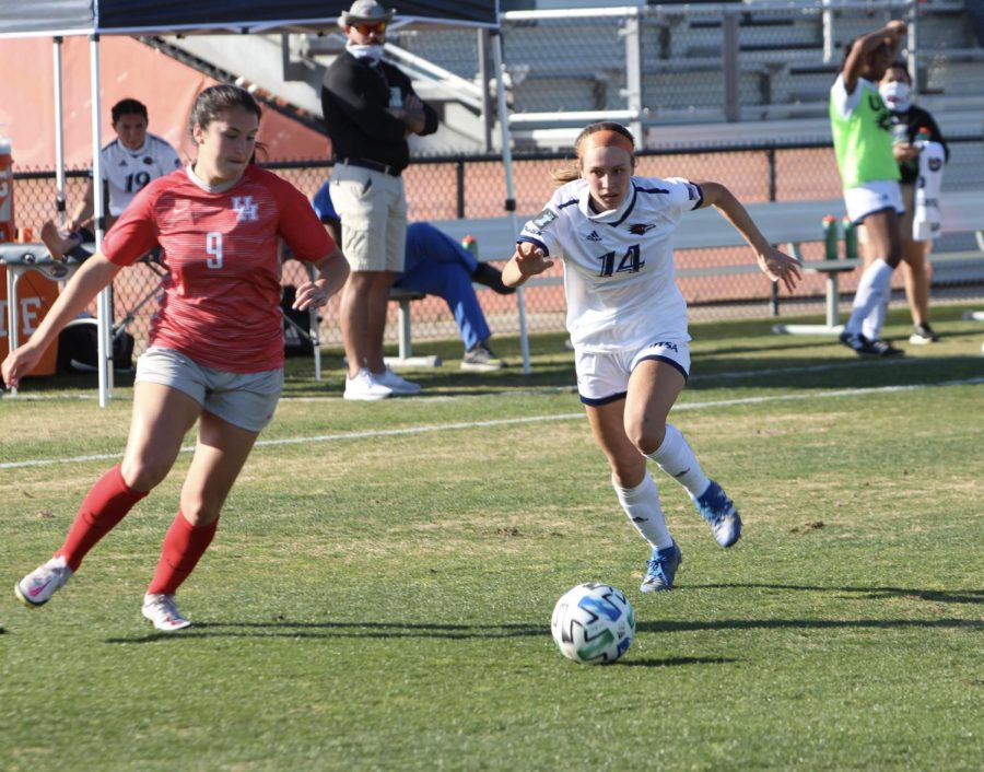 Ellis Patterson races a defender for a ball earlier this season. Patterson picked up her second assist of the season on Monday against UTEP.