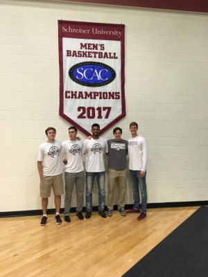 Preston Bigley and teammates pose under their championship banner. Schreiner University was the Southern Collegiate Athletic Conference Champions in 2017.