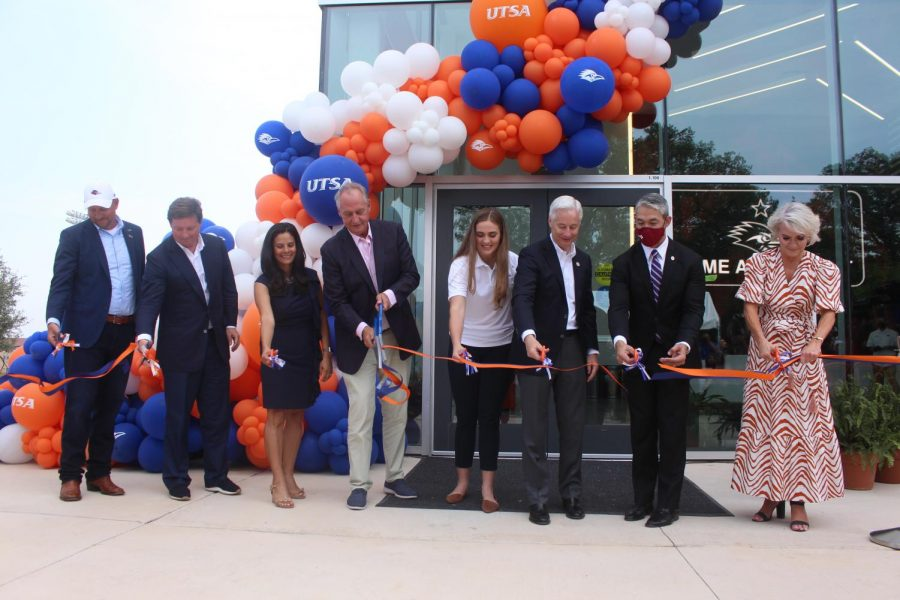 Various guests, donors and university officials including President Eighmy and Mayor Ron Nirenberg cut the ribbon to open the Roadrunner Athletics Center of Excellence. Julia Maenius\The Paisano