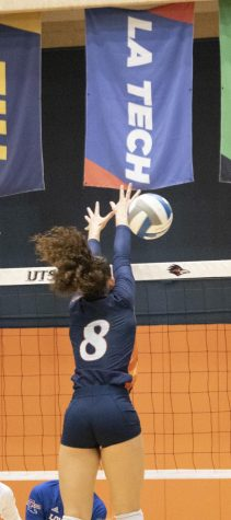 Courtney Walters blocks a shot during this weekends series against LA Tech. Walters recorded four blocks in Fridays victory. Dalton Hartmann/The Paisano