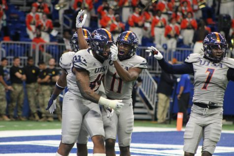 The UTSA defense celebrates after recording a tackle for loss in the second quarter. The UTSA defense held Lamars offense to 122 yards, securing them the first shutout in school history. Seva Hester/The Paisano