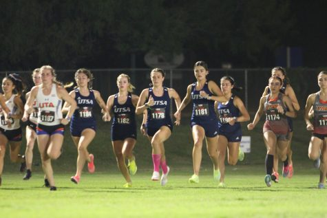 The UTSA womens cross country team dashes away from the start line during their race on Friday night. The team finished in sixth place overall, with Lily Morrill leading the team with a 16:01.1. Julia Maenius/The Paisano