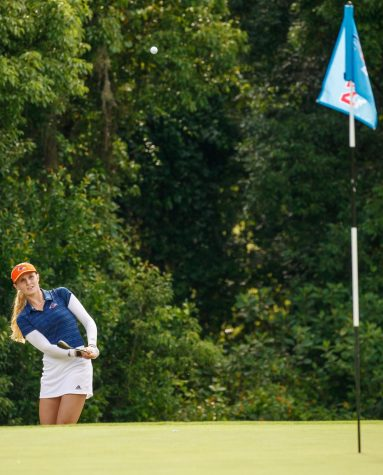 Hannah Holzmann chips a ball onto the green during last years C-USA Championships. Holzmann was the highest placed Runner at the Mercedes-Benz Collegiate Championship, finishing in a tie for ninth after shooting one over par in the tournament. Photo courtesy of Conference USA