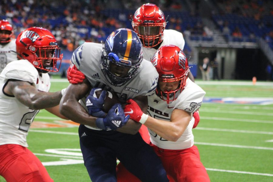 DeCorian Clark fights through multiple UNLV defenders to gain extra yardage. in the absence of standout receiver Zakhari Franklin, Clark stepped up and had a career day, catching seven passes for 109 yards and a touchdown. Seva Hester/The Paisano